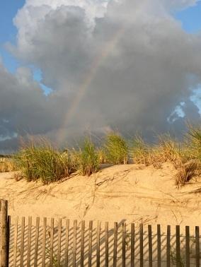 rainbow over dunes
